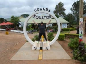 Ali Filbert poses for a photo at the equator in Uganda. (Photo provided)